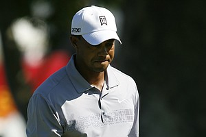 Tiger Woods reacts after just missing a short putt on the 13th green during the second round of the Frys.Com Open.
