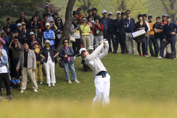 Rory McIlroy watches his shot on the second hole during the first round of the Korea Open at Woo Jeong Hills Country Club in Cheonan, south of Seoul, South Korea.