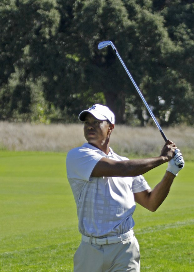 Tiger Woods follows his shot on the 12th fairway during the third round of the Frys.Com Open.