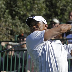 Tiger Woods hits off the 13th tee during the third round of the Frys.com Open.
