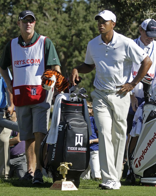 Tiger Woods, right, and his caddie Joe LaCava prepare to walk on the 13th fairway during the third round of the Frys.com Open.