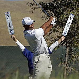 Tiger Woods hits off the 11th tee during the third round of the Frys.com Open.