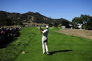 Tiger Woods makes a tee shot on the 13th hole during the third round of the Frys.com Open.