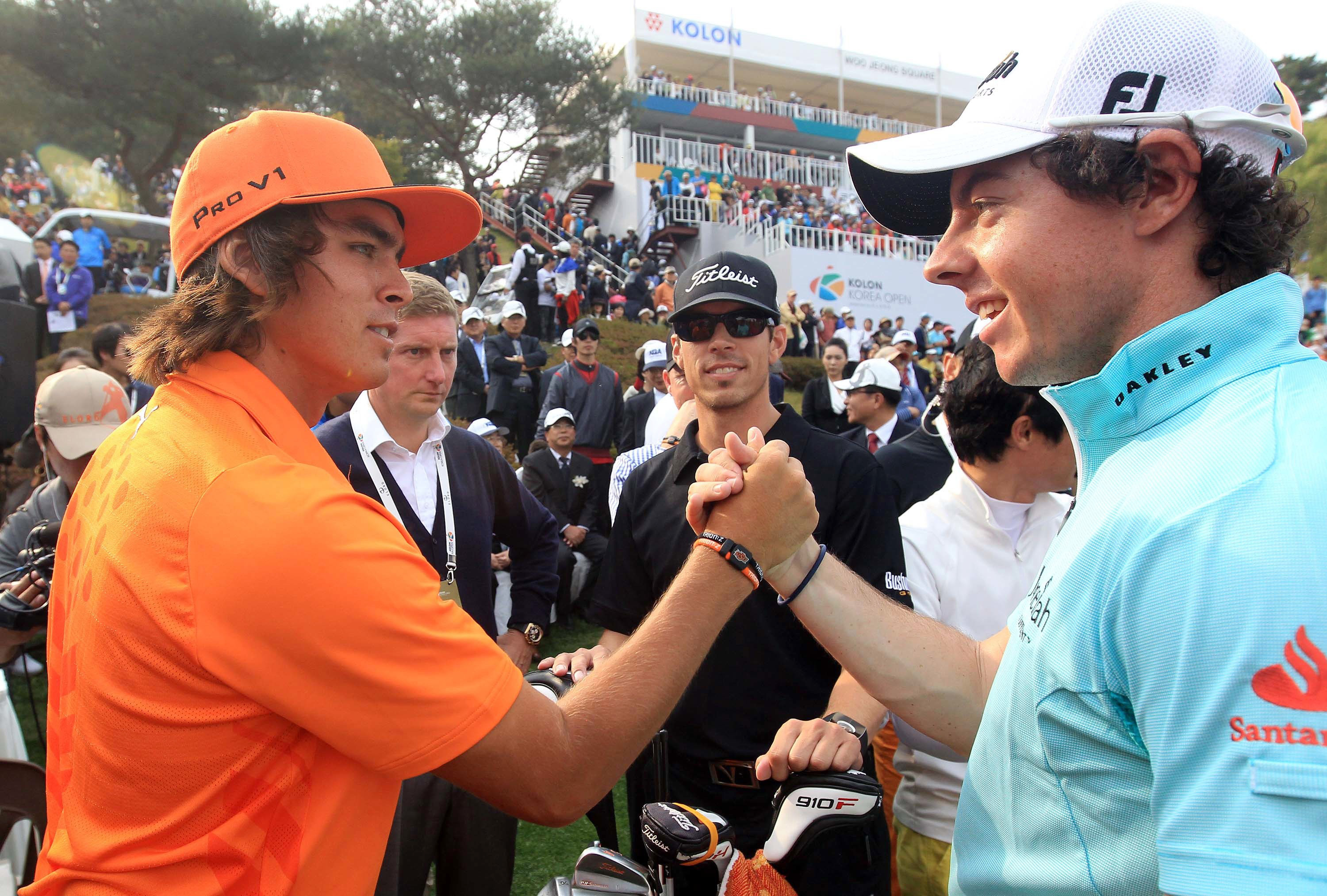 Rickie Fowler (left) receives congratulations from Rory McIlroy after winning the Korea Open. Fowler shot 16-under 268.