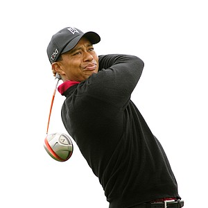 Tiger Woods makes a tee shot on the 12th hole during the final round of the Frys.com Open at the CordeValle Golf Club.