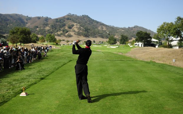 Tiger Woods makes a tee shot on the 13th hole during the final round of the Frys.com Open at the CordeValle Golf Club.