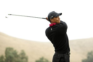 Tiger Woods makes a tee shot on the 11th hole during the final round of the Frys.com Open at the CordeValle Golf Club.
