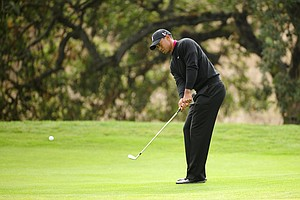 Tiger Woods hits his chip shot on the 12th hole during the final round of the Frys.com Open at the CordeValle Golf Club.