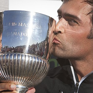 Lee Slattery of England kisses the trophy after winning the Madrid Masters.