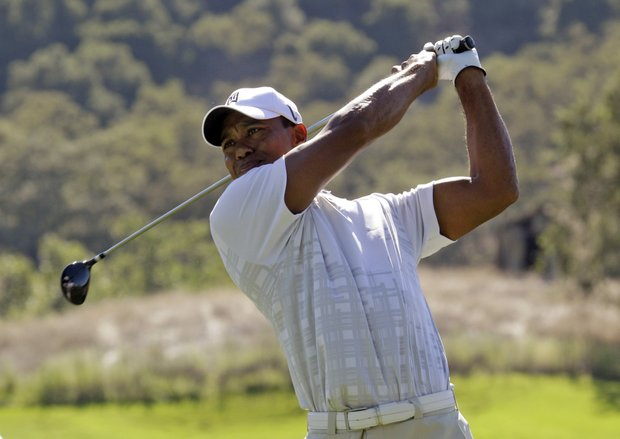 Tiger Woods hits off the ninth tee during the third round of the Frys.Com Open.