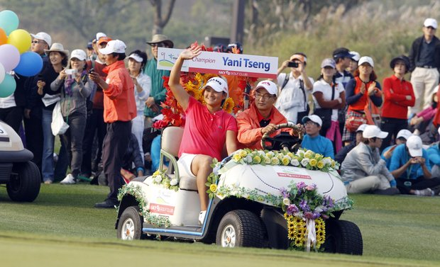 Yani Tseng waves as she arrives for the winner's event for the LPGA Hana Bank Championship golf tournament at Sky72 Golf Club Ocean course in Incheon, west of Seoul, South Korea.