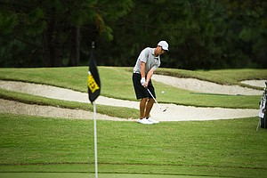 Guilford freshman Drew Thompson chips onto the 10th green at the Golfweek Fall Invitational.
