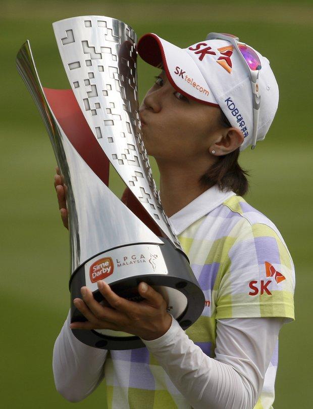 Na Yeon Choi of South Korea kisses her trophy after winning the LPGA Malaysia in Kuala Lumpur, Malaysia.