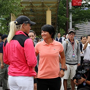 Yani Tseng, center, talks with Suzann Pettersen during an LPGA press conference near Taipei 101.