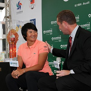 LPGA Commissioner Mike Whan (right) talks with Yani Tseng, newly announced Rolex Player of the Year, during a LPGA press conference near Taipei 101.