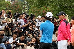 Na Yeon Choi, Suzann Pettersen and Yani Tseng, far right, stand in front of a mass of Asian media during an LPGA press conference near Taipei 101.
