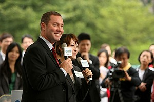 LPGA Commissioner Mike Whan with an interpreter during an LPGA press conference near Taipei 101.