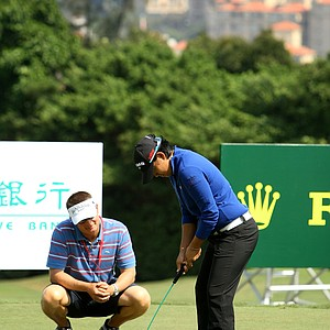 Yani Tseng works with caddie Jason Hamilton before the Sunrise LPGA Taiwan Championship at Sunrise Golf and Country Club.