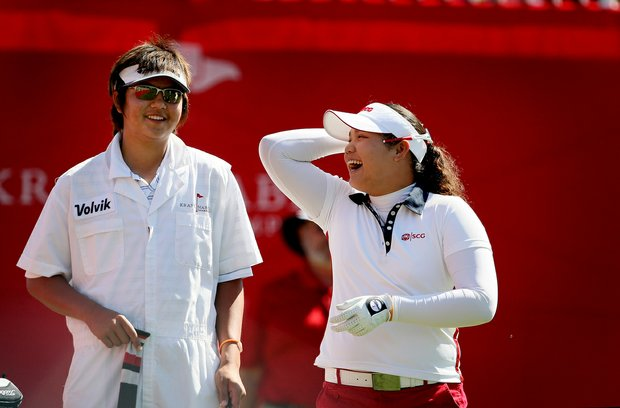Ariya Jutanugarn laughs with caddie and friend K. K. Limbhasut during the final round of the Kraft Nabisco Championship.