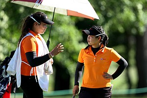 After falling in the second round of match play at the U.S. Women's Amateur, Ariya Jutanugarn caddied for older sister Moriya.