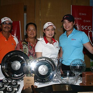 The Jutanugarns with a summer's worth of trophies.