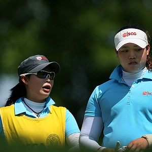 Moriya (left) and Ariya Jutanugarn during the U.S. Girls' Junior. Moriya caddied for Ariya after withdrawing from the tournament with a wrist injury.