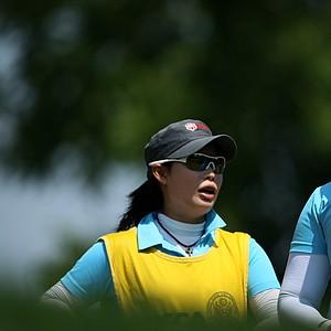 Moriya (left) and Ariya Jutanugarn during the U.S. Girls' Junior. Moriya caddied for Ariya after withdrawing from the tournament with a wrist injury.