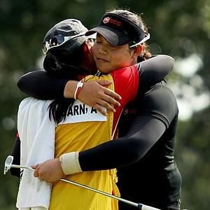 Moriya (left) and Ariya Jutanugarn embrace after Ariya won the U.S. Girls' Junior in at Olympia Fields (Ill.) Country Club in July.
