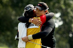 Moriya (left) and Ariya Jutanugarn embrace after Ariya won the U.S. Girls' Junior in at Olympia Fields (Ill.) Country Club in July.