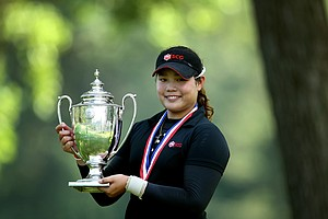 Ariya Jutanugarn holds the U.S. Girls' Junior trophy. It was her first USGA win.