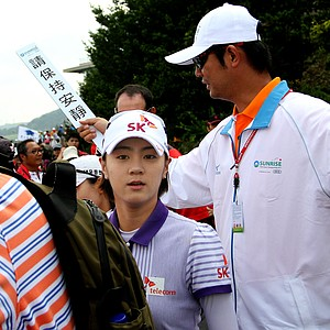 Last week's winner Na Yeon Choi attempts to make her way to the first tee.