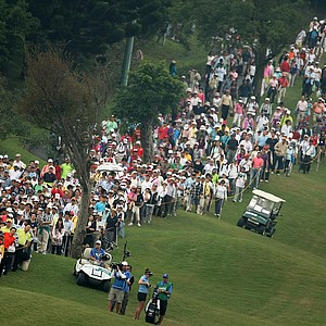 Crowds line the fairway at No. 9 as Brittany Lang and Yani Tseng negotiate their shots. Yani Tseng is tied for the lead after Round 1.