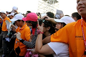 Fans try to get pictures of Yani Tseng after she finished Thursday's round. Thousands came out to see the hometown hero.