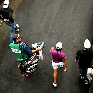 Yani Tseng and her caddie Jason Hamilton, along with security make their way to the 9th tee during Friday's round.