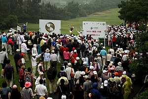 Yani Tseng hits her tee shot at No. 9 as crowds make their way toward the fairway.
