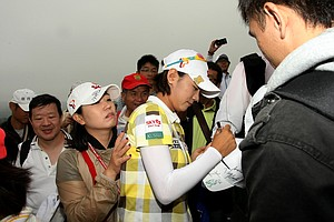 Na Yeon Choi signs autographs after Friday's round.