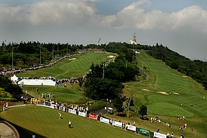 A large ring of fans surround the first green during Yani Tseng's tee time on Saturday's round. The fairway to the right, the 9th hole has a few less spectators.