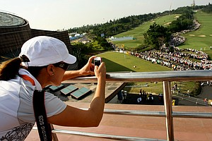 LPGA player Sophie Gustafson climbed to the rooftop of Sunrise Golf and Country Club to get pictures of the Yani Tseng madness during Saturday's round.