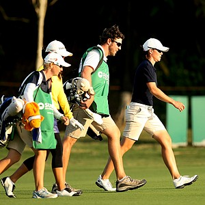 Katie Futcher, far right, walks up the fairway at No. 17. Futcher is in 6th place heading into the final round.