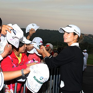 Beatriz Recari signs autographs after Saturday's round.