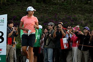 Yani Tseng walks up to the 18th tee during Saturday's round.