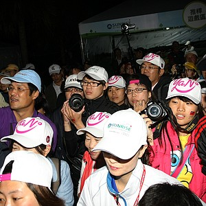 Fans crowd around a booth where Yani Tseng spent Saturday evening shaking hands after Saturday's round where she took the outright lead.