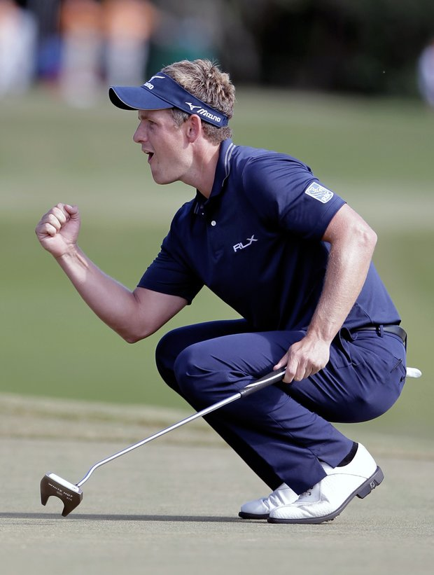 Luke Donald reacts after sinking a birdie putt on the 15th hole during the final round of the Children's Miracle Network Classic. Firing a final-round 64, Donald went on to win by two, clinching the PGA Tour money title.