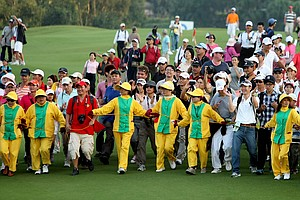The Sunrise Golf and Country Club security tries to keep fans who rushed the fairway at No. 18 from going any further during the final round of the inaugural 2011 Sunrise LPGA Taiwan Championship.