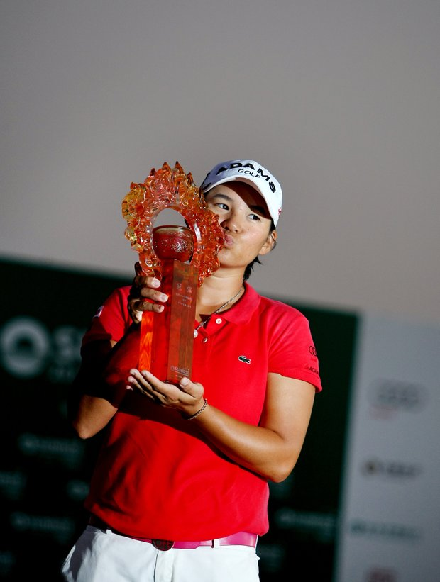 Yani Tseng kisses the trophy after winning the tournament by five strokes at the inaugural 2011 Sunrise LPGA Taiwan Championship.