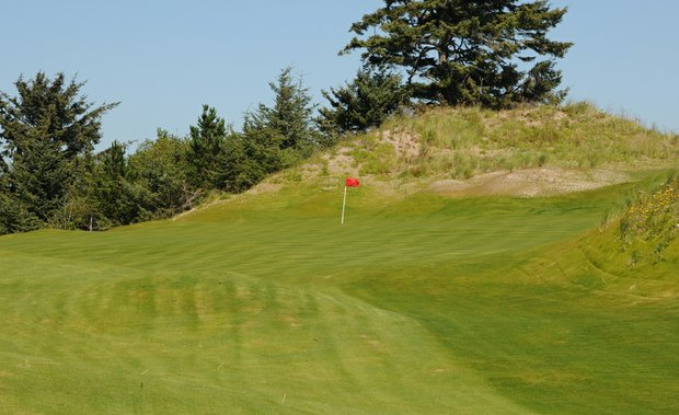 Note the sloped green on the 11th that is not visible from the tee.  Of course long is a problem with the large mound in the background, leaving the right side the safest route, but with the slope and mounding, getting up and down will be difficult.