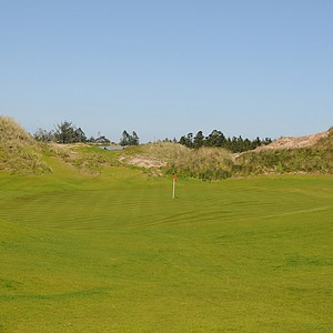 With the Pacific Ocean in your rearview mirror the 12th hole is maybe the least adventurous.  Surrounded by mounds and sitting in the valley, the 12th hole can cause problems, but not likely.