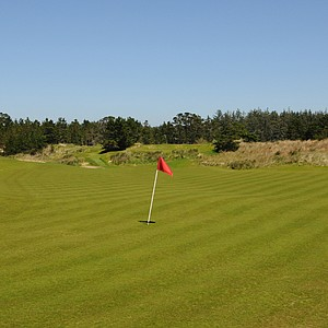 As you can see the first is a large green running from back to front.  You will notice a little movement in the green from left to right, but with pure fescue the green will run very true. Note the mounding on the right side of the green that can be beneficial at times providing a gentle carom to the hole location. But, at the same time, a misplayed tee shot could get caught in the native grasses on the side of mound, leaving a difficult up and down.