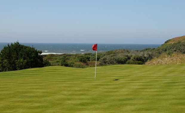 The closest of any holes, the sixth green is a great view of the Pacific Ocean.  Also notice the movement on the green near the back on the ocean side.