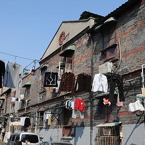 A typical street in Old Town Shanghai with the clothes drying from high above.